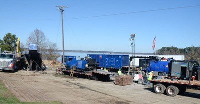 Contractors use equipment to bore underneath a body of water to complete a C Spire long haul fiber route. The company recently completed a 225-mile fiber route from Kiln, Mississippi to West Mobile, Alabama, overcoming weather delays, permitting requirements and sensitive environmental issues.
